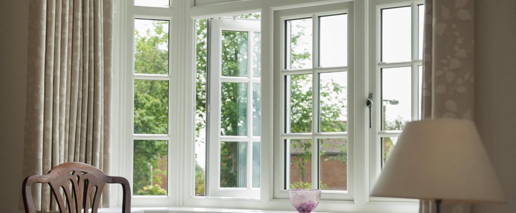 Internal living room view of white casement windows
