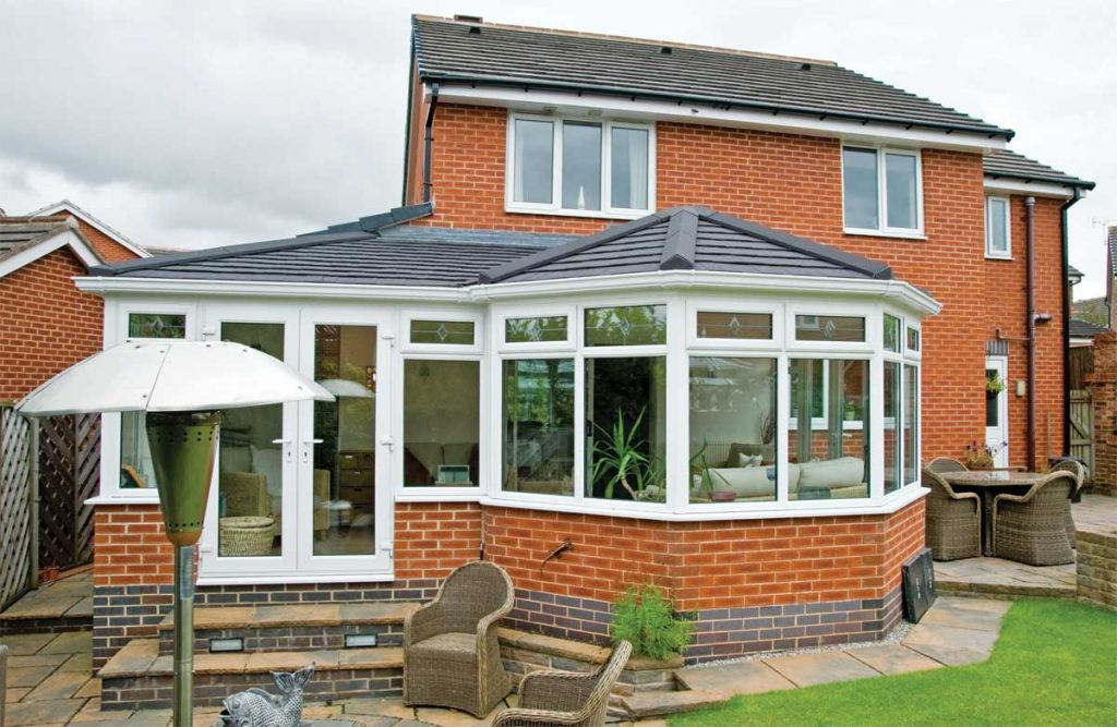 Tile conservatory roof added to existing conservatory for a warmer solution