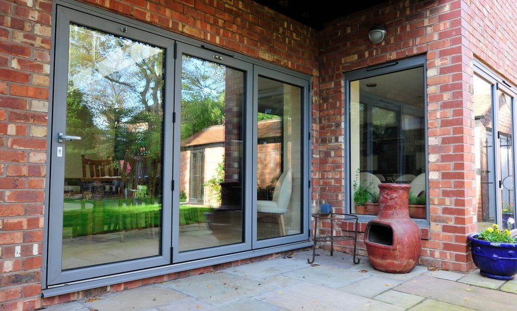 Anthracite grey with aluminium bifolds and window