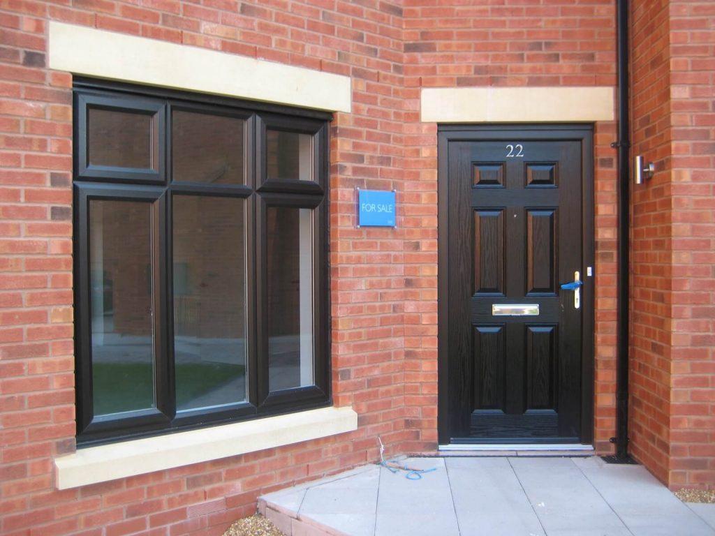 Black ash composite door and uPVC windows