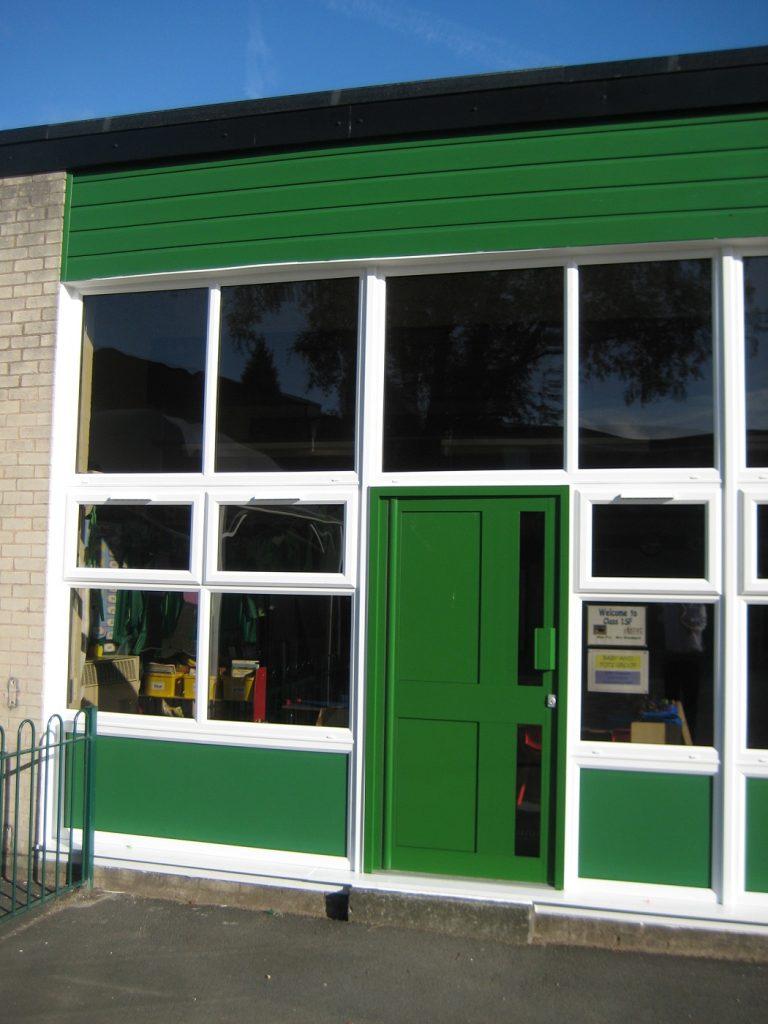 White uPVC windows Green aluminium door