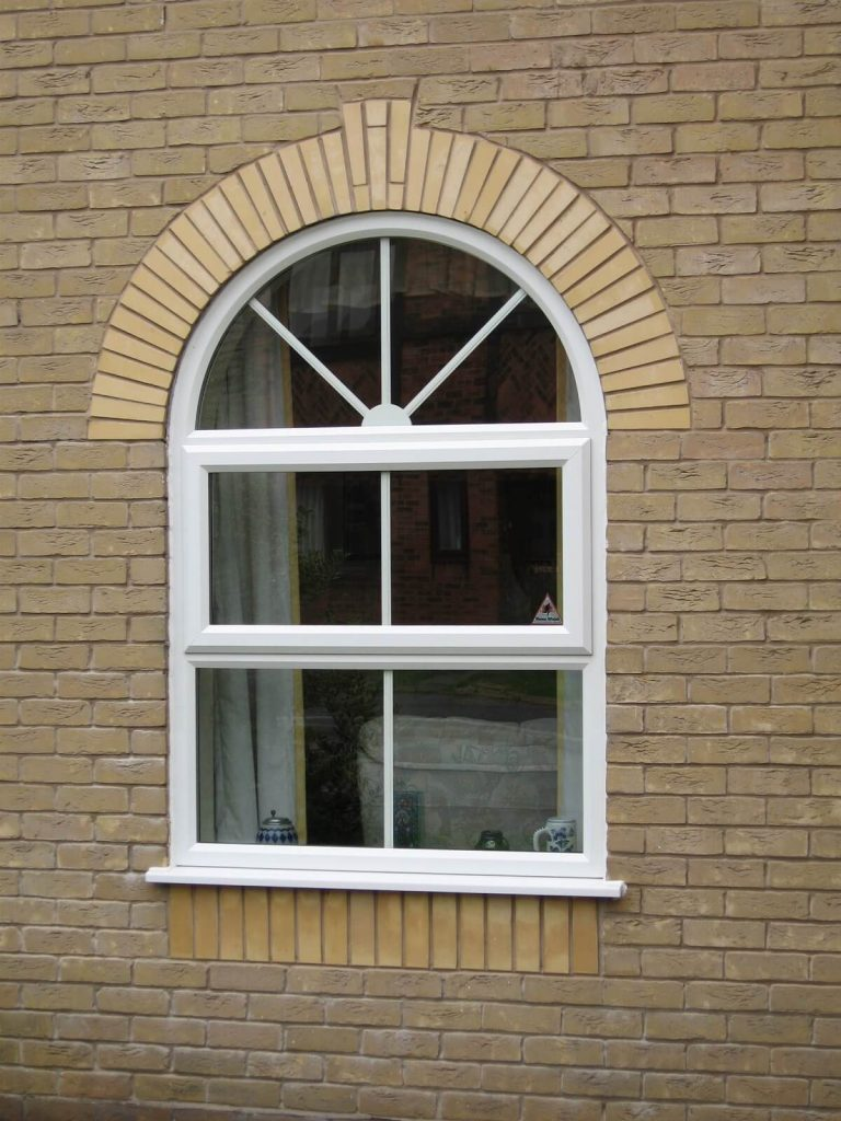 Arched uPVC window in white