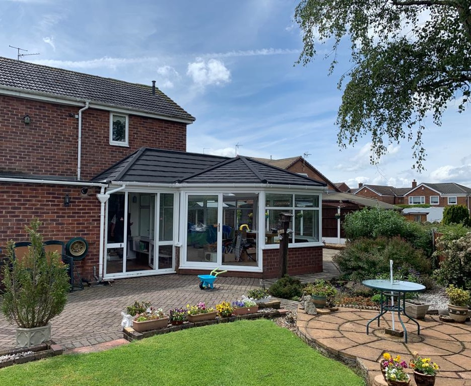 Black tiled roof replacement in Ashton-under-Lyne